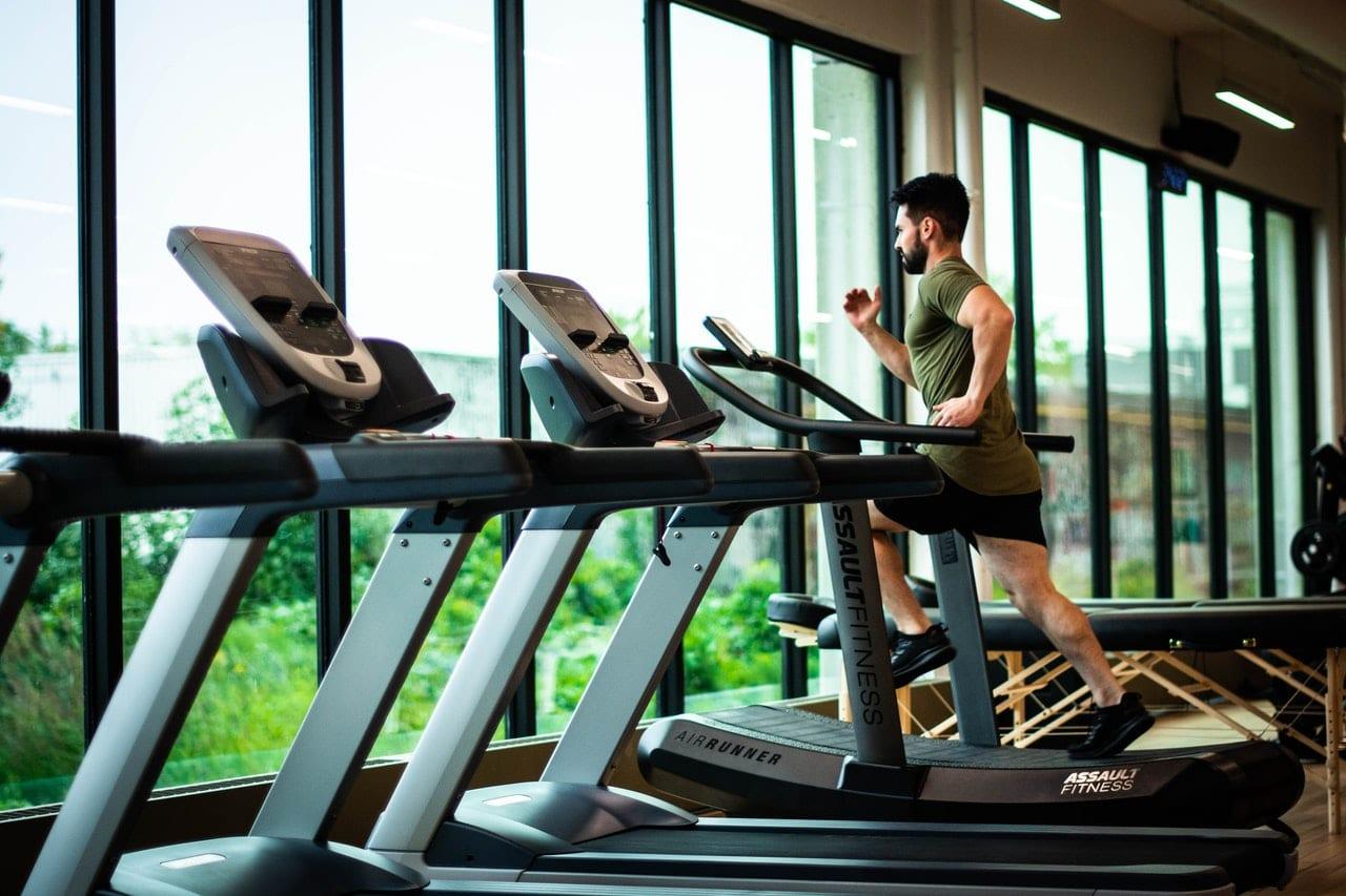 Man Running on Treadmill in a Gym