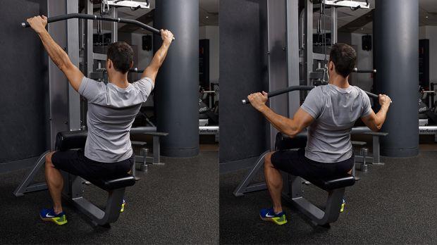Man Doing Lat Pulldown At Gym