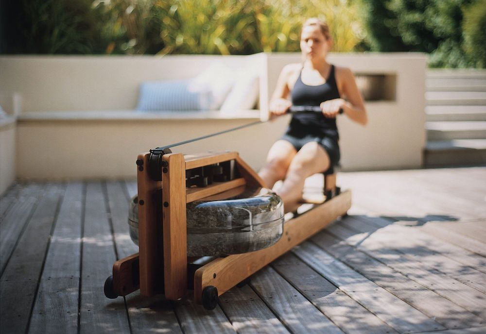 woman using a water rower