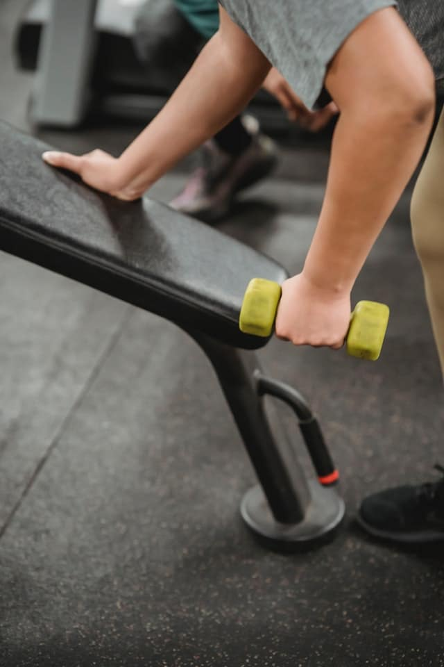 person performing bent over dumbbell row